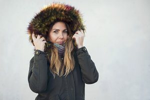 pretty girl with coat in winter