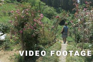 Young girl walking in tropical botanical garden. Batumi, Georgia