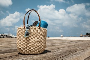 Straw Bag On Wooden Bridge