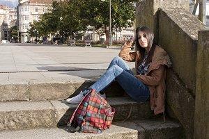 latina brunette girl sitting outdoor