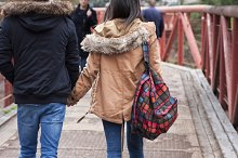 young couple holding hands walking