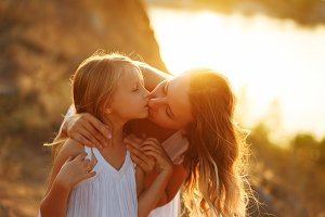 Family. Mother and daughter. Kiss