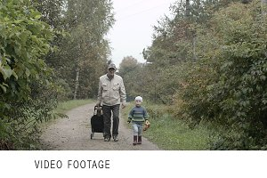 Grandad and grandson walking.