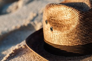 Straw Hat On A Tropical Sandy Beach