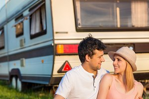 Young couple in the caravan.
