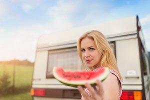 Young woman in the caravan.