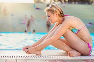 Couple at swimming pool.