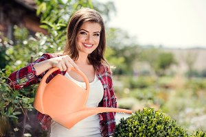 Beautiful young woman gardening