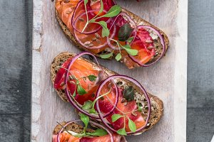 Cured salmon gravlax on a crusty bread