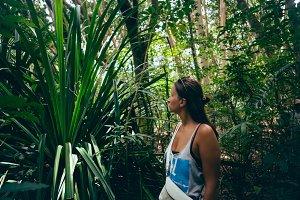 Woman traveler dense tropical forest