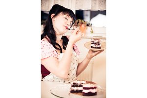 Vintage Girl Enjoying A Piece Of Cake