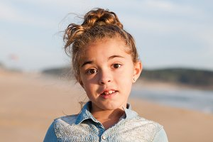 Little girl portrait on the beach