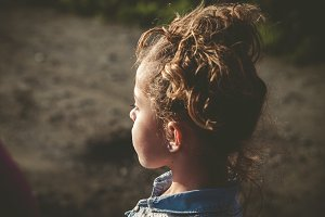 Little girl looking aside outdoors
