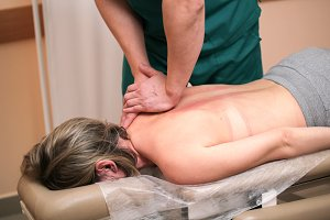 Alternative medicine - doctor osteopath have manual therapy for woman's back