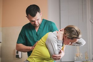 Neuropathology - doctor osteopath have manual therapy for woman's neck