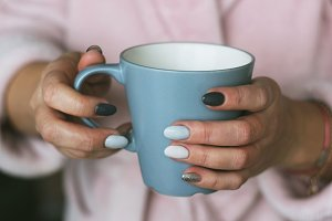 a cup of tea in hands