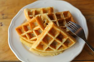 plain waffles served on plate for breakfast close up top photo