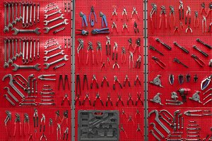 Professional work tools hanging on steel wall