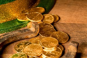 Pile of gold coins from green hat St Patricks Day