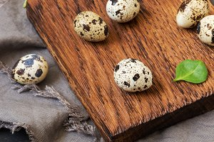 Quail eggs on a cutting board. Feast of Easter.
