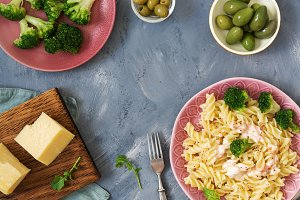 Pasta with broccoli, cheese and olives . The view from the top ,place for text. Italian dish