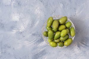 Olives close-up on a gray background, top view, copy space.