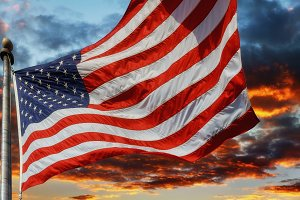Flag USA over beautiful sunset sky