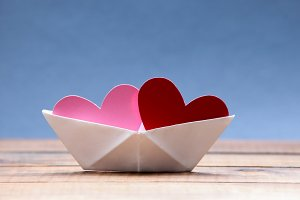 Paper hearts inside paper boat