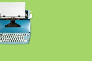 Old electric typewriter on plain background