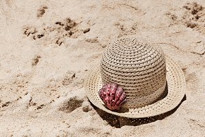Closeup Of Straw Hat On The Sand