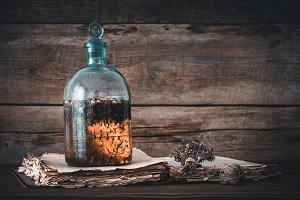 Potion bottle and old book.