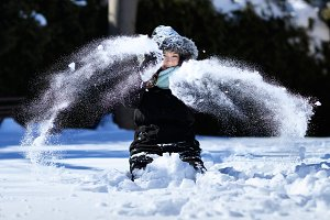 Pretty girl juggling with snow