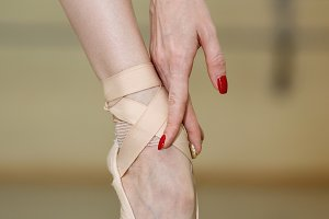 Leg and arm of ballerina. Pointe