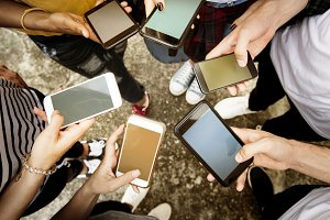 Young adults using smartphones