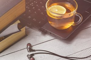 cup of tea on laptop and book. Relaxing time concept