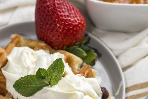 Waffle with cream raspberries and ch