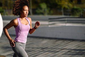 Black woman, afro hairstyle, running