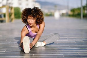 Young black woman doing stretching