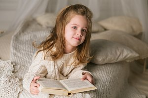 A pretty little girl with a book