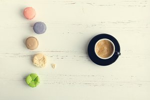 Coffee and colorful macaroons