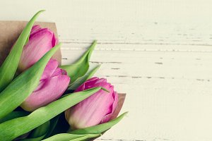 Bouquet of tulips on white shabby chic background