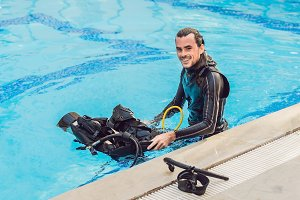 Portrait of a happy diving instructor, ready to teach diving in the pool