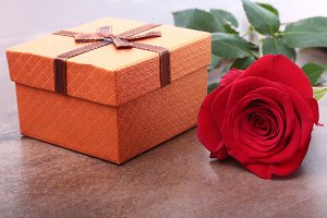 Gift box with bow and rose