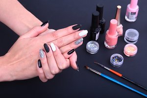 Black, white Nail art manicure.