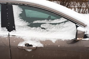 The car in the snow, covered with white snowdrift.