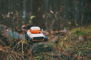 old broken toy car in the woods