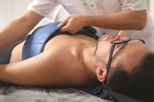 Osteopathic doctor perform procedure, stretching the spine, chiropractic, Asian Tibetan medicine