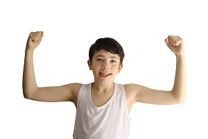 teen boy show weak biceps muscles smiling close up photo