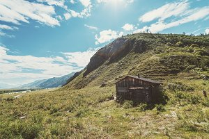 Wooden shepherd's house in mountains