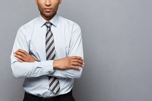 Business Concept - Happy professional african american businessman confident arms crossed.